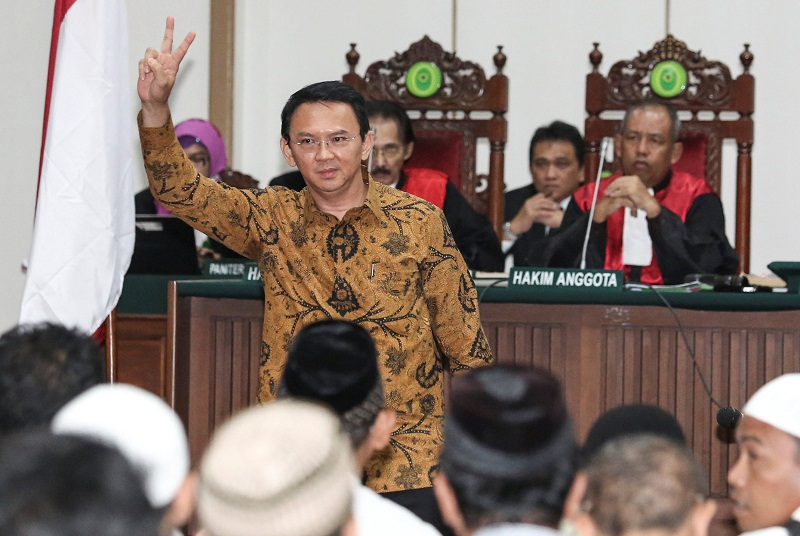 Jakarta's Governor Basuki Tjahaja Purnama, also known as Ahok, reacts inside the courtroom during his blasphemy trial at the auditorium of the Agriculture Ministry in Jakarta January 3, 2017. — Reuters pic