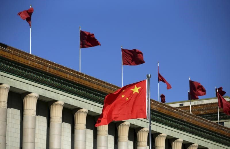 Chinese flag waves in front of the Great Hall of the People in Beijing October 29, 2015. — Reuters pic