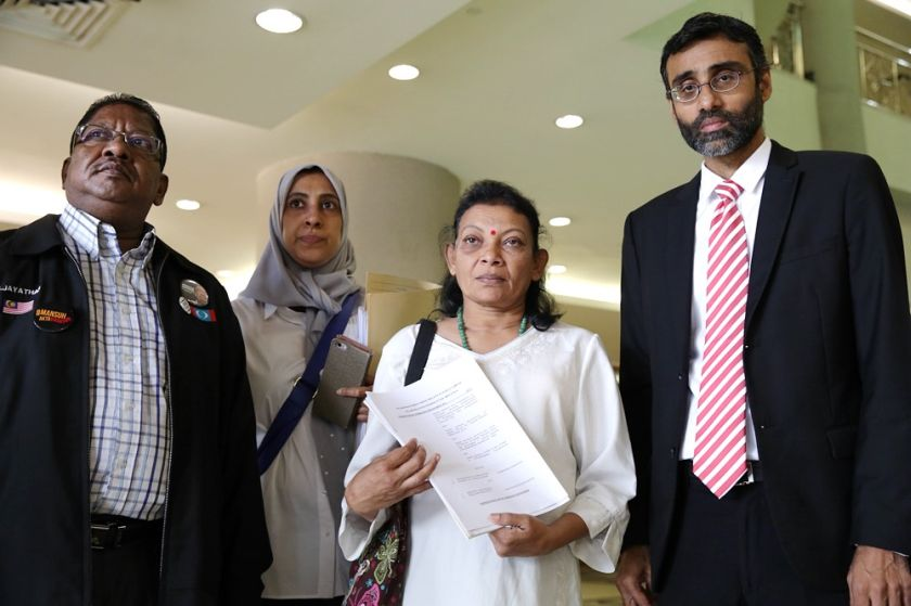 Prabagaran Srivijayan's mother Eswary Vengatasamy is pictured with lawyer N. Surendran (right), at the Duta court, January 16, 2017. — Picture by Choo Choy May