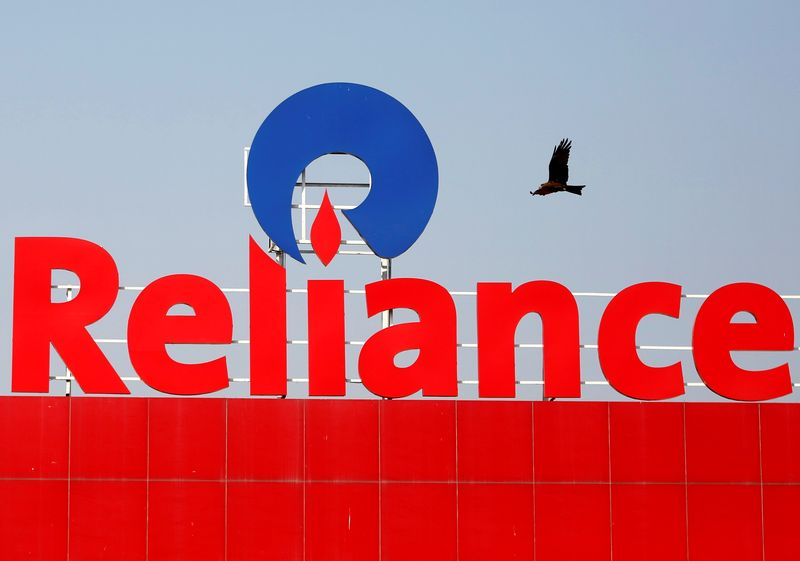 A bird flies past a Reliance Industries logo installed on its mart in Ahmedabad, India January 16, 2017. — Reuters pic