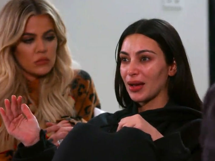 Kim Kardashian breaks down as she recounts her Paris robbery to her sisters Khloe and Kourtney. — Screengrab from E Online video