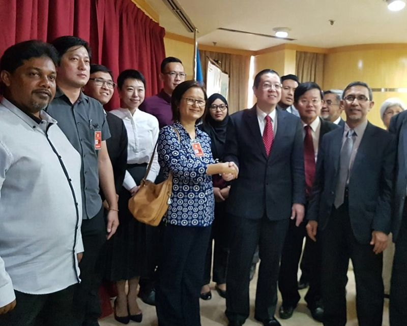 Penang Chief Minister Lim Guan Eng congratulating the newly appointed councillors at his office.