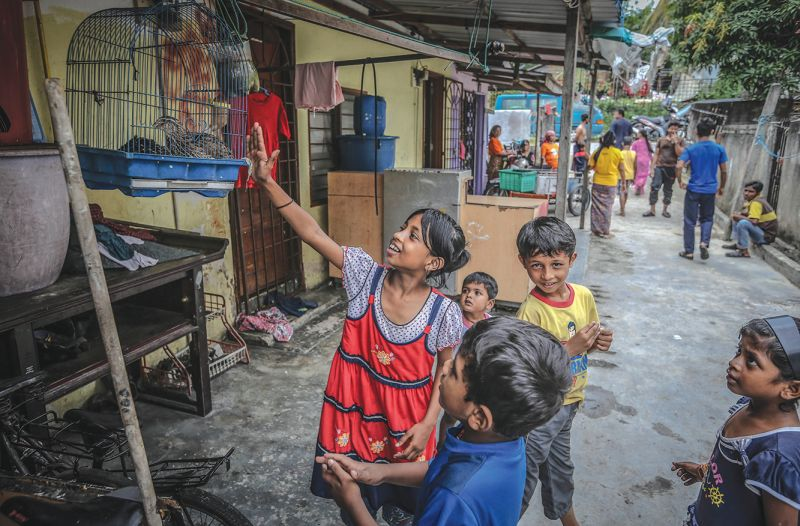 Children play outside their homes in Kampung Tasik Permai. Many of them get sick because of the unhygenic living conditions. — Picture by Firdaus Latif