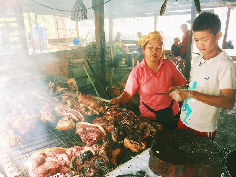 Smoked wild boar meat is a delicacy popular with the young and old.