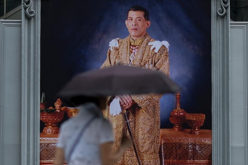 A woman walks past a portrait of Thailand's King Maha Vajiralongkorn Bodindradebayavarangkun at a department store in central Bangkok January 13, 2017. — Reuters pic