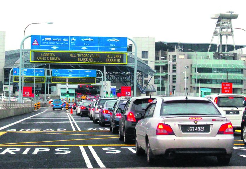 The lowered toll charges mirror Malaysia's toll reduction for cars, buses and taxis at the Sultan Iskandar and Tanjung Kupang toll plazas. — TODAY pic