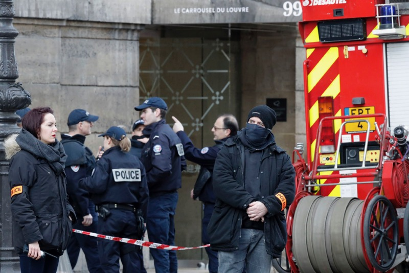 French police and emergency services are seen in front of the street entrance of the Carrousel du Louvre in Paris, France, February 3, 2017. —  Reuters pic