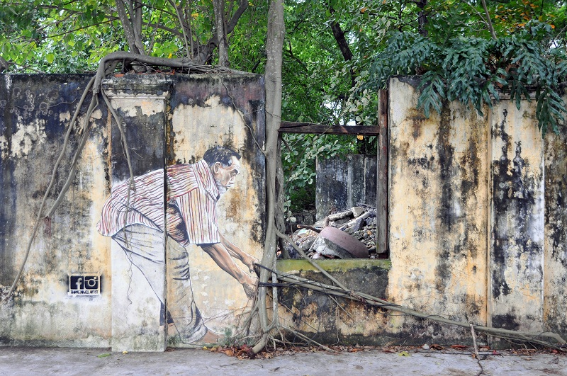 'Bounties of the Sea' painted by Thomas Powell on the ruins of an abandoned building.