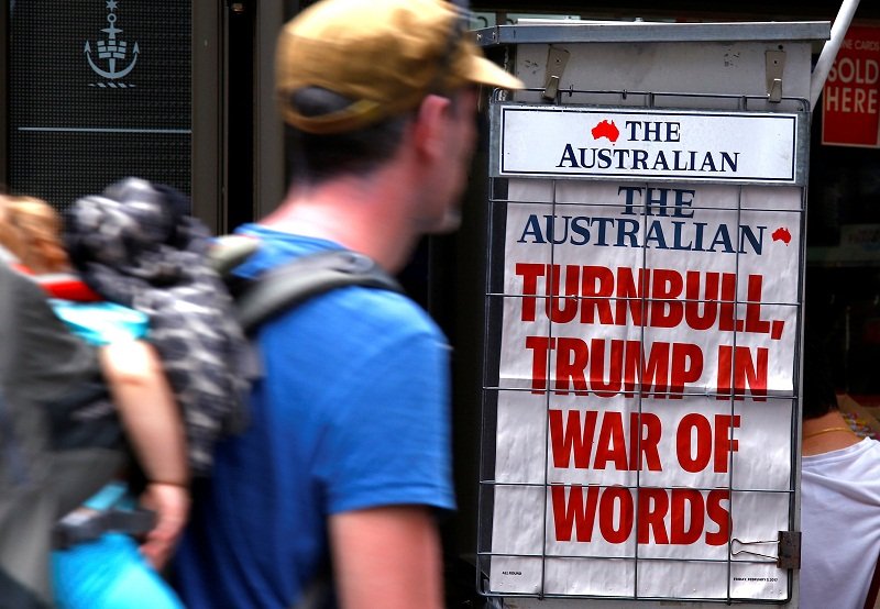 A pedestrian looks at a newspaper headline regarding US President Donald Trump and Australian Prime Minister Malcolm Turnbull in central Sydney February 3, 2017. — Reuters pic