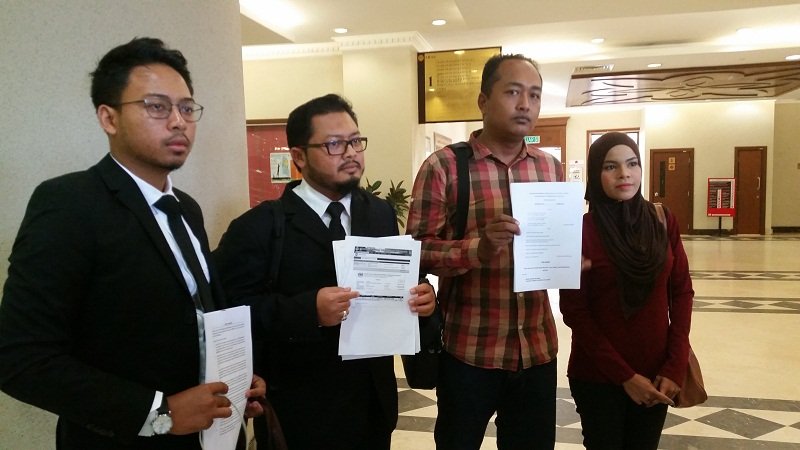 (From left) Lawyers Adam Luqman and Yusfarizal Yussoff with their clients Mohd Ridhuan Giman and Siti Sarah Maulad Abdullah who are suing JAWI for wrongful khalwat raid and arrest. — Picture by Ida Lim