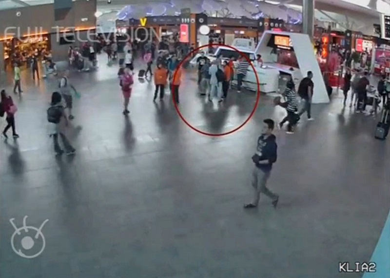 A still image from a CCTV footage appears to show a man purported to be Kim Jong-nam (circled in red) talking to airport staff, after being accosted by a woman in a white shirt, at KLIA2 on February 13, 2017. — Reuters pic