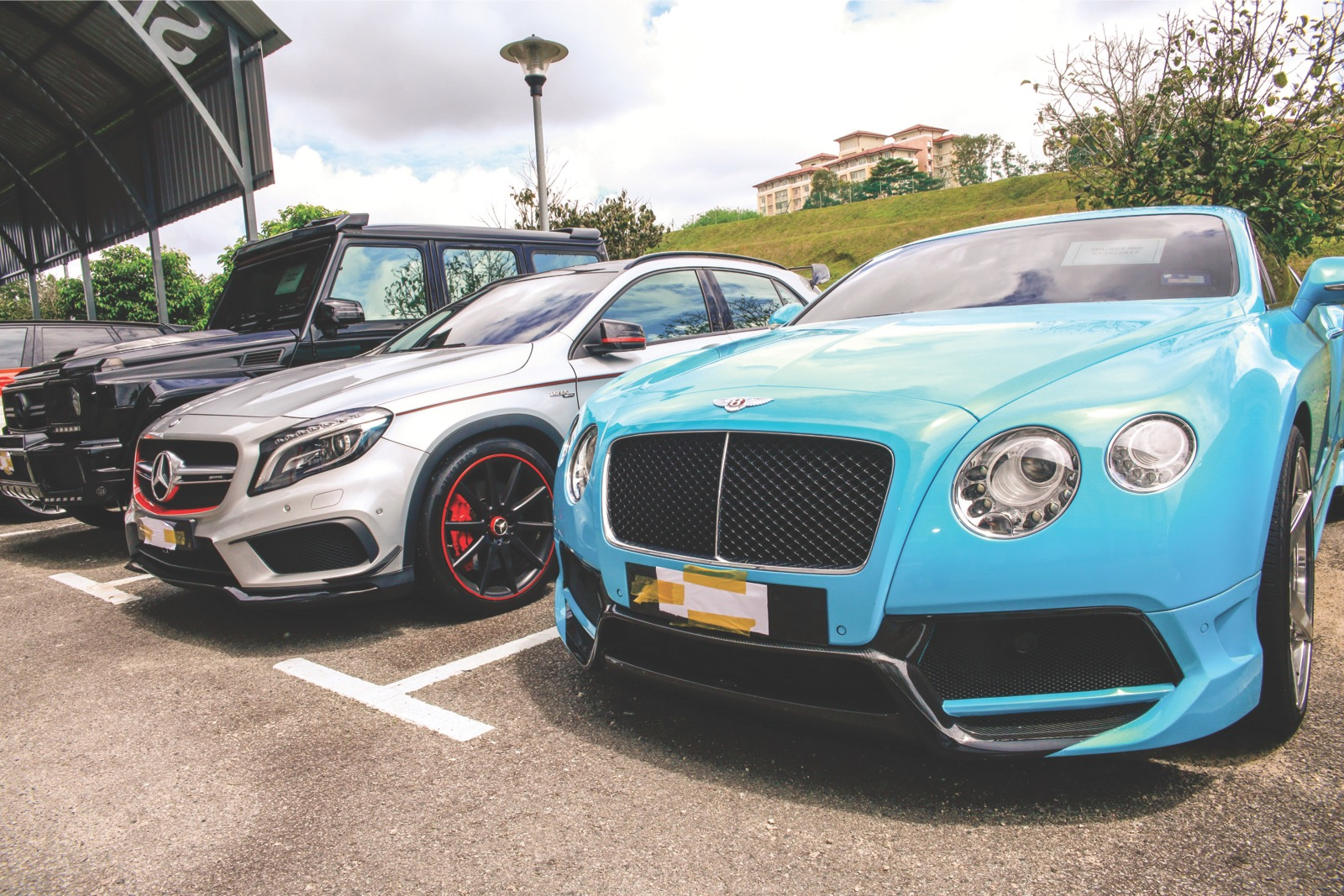 Luxury cars owned  by Ahmad Fauzan. — Picture by Malay Mail