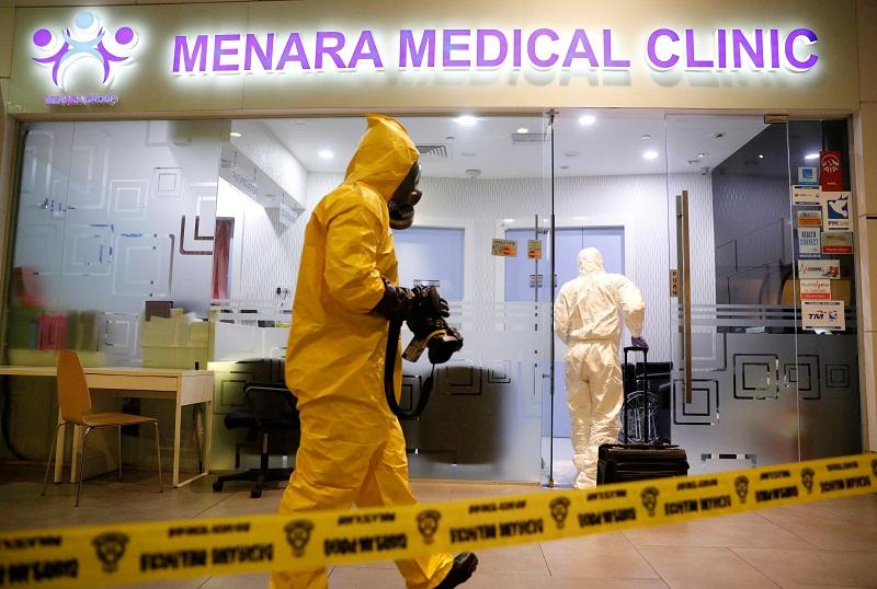 A Hazmat team conducts checks at a clinic at KLIA2 airport terminal in Sepang February 26, 2017. — Reuters pic