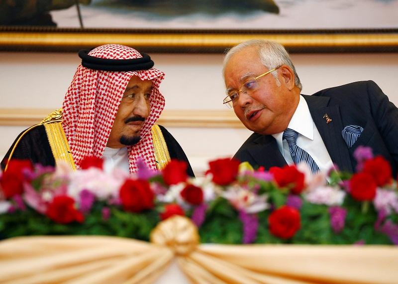 Saudi Arabia's King Salman speaks with Prime Minister Datuk Seri Najib Razak during a Memorandum of Understanding signing ceremony in Putrajaya February 27, 2017. — Reuters pic
