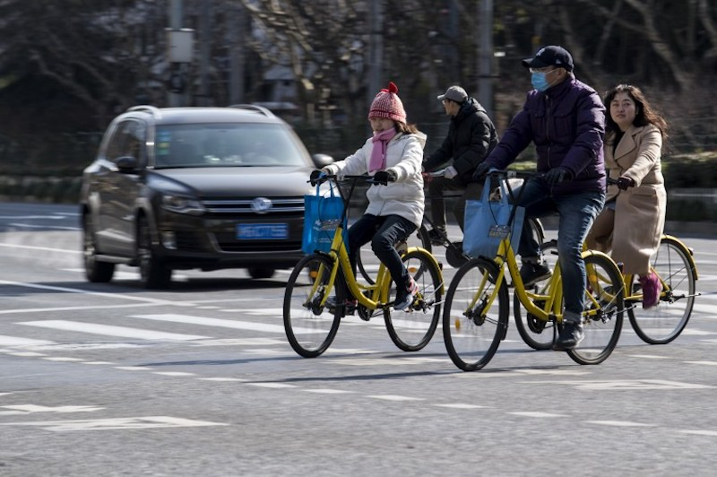 People ride Ofo-bicycles on the street in Shanghai February 2, 2017. — AFP pic