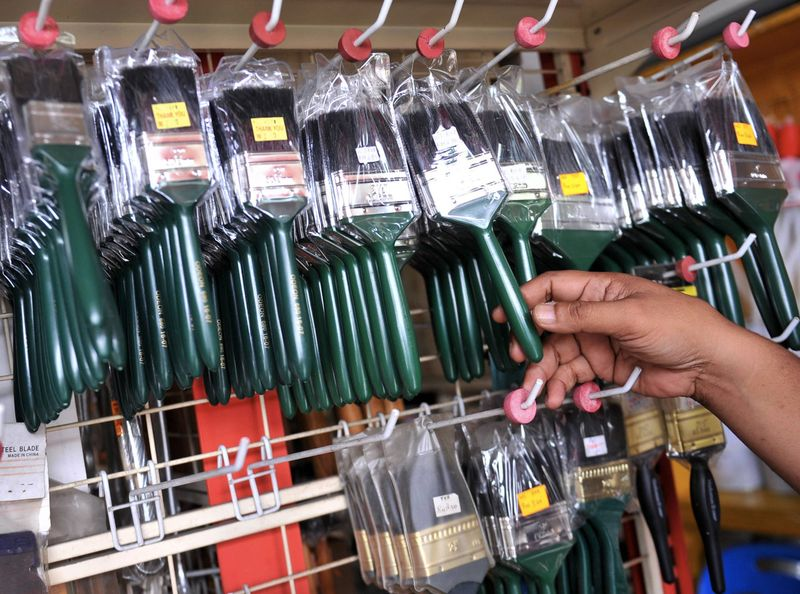 KPDNKK offcers in Selangor check the paintbrushes believed to be made of pig bristles, February 7, 2017. ― Bernama pic