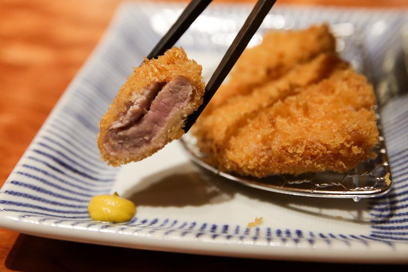 Juicy pork loin tonkatsu is cooked medium rare at Tonkatsu Anzu. — Picture by Choo Choy May