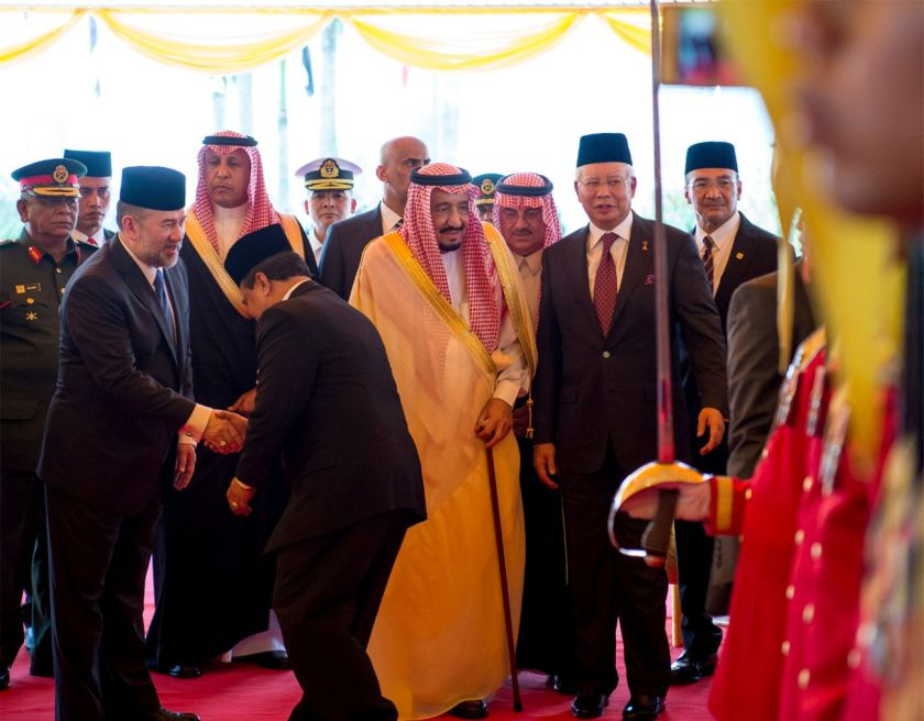 Saudi Arabia's King Salman (centre) stands next to Malaysia's Prime Minister Najib Razak (second from right) and Malaysia's Sultan Muhammad V (second from left) during a welcoming ceremony in Kuala Lumpur, Malaysia, February 26, 2017. — Reuters pic