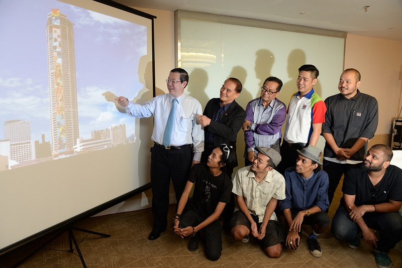 Penang Chief Minister Lim Guan Eng showing an artist's impression of the mural at the announcement of the 'world's tallest mural' project at Komtar, George Town March 9, 2017. — Pictures by K.E.Ooi