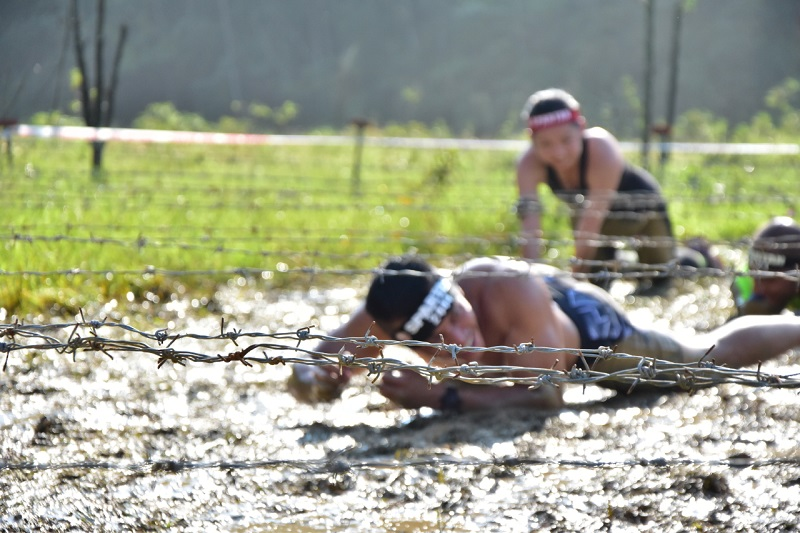 The barbwire at the 'mud crawl' obstacle was particularly low, not allowing one to simply roll to the other end.