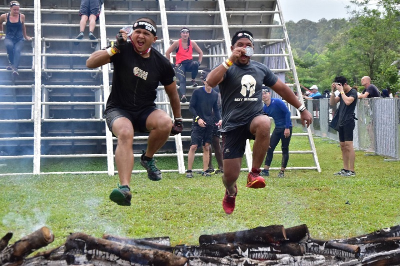 Two participants jumping for joy after completing the Spartan Race last Sunday.