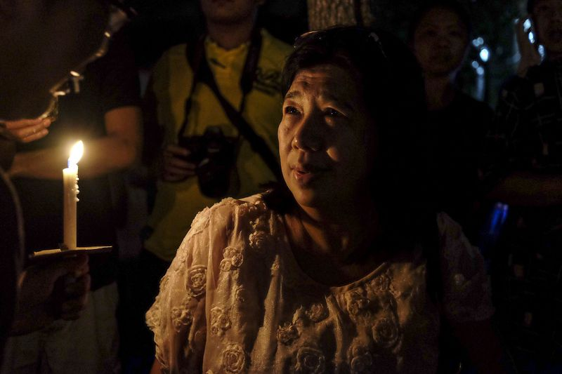The wife of missing Pastor Raymond Koh, Susanna Liew attending the candlelight vigil held outside the Selangor police headquarters in Shah Alam, March 5, 2017. — Picture by Yusof Mat Isa
