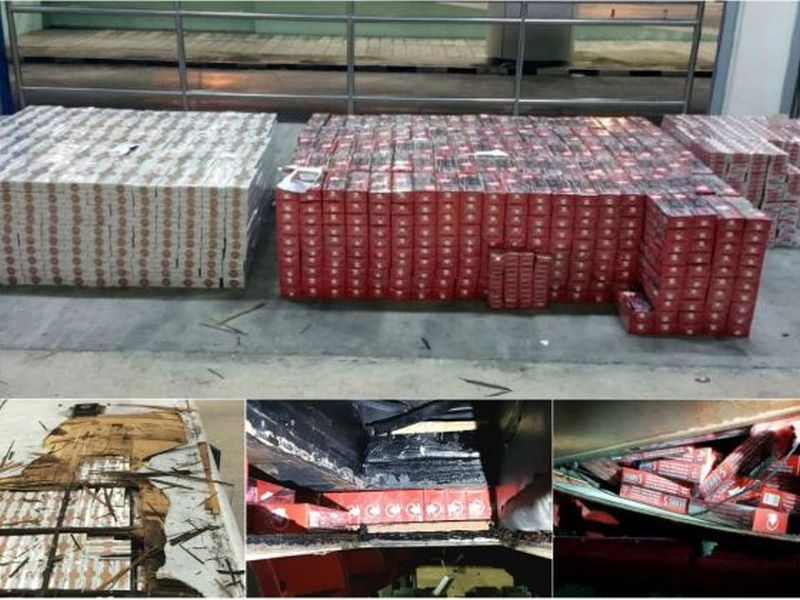The total amount of cigarettes seized which were hidden in the roof compartment, the air con duct  and the roof luggage compartment. ― Picture  courtesy of Immigration & Checkpoints Authority/TODAY