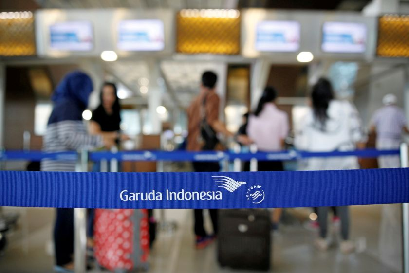 Travellers line up at Garuda's check in counter at the Soekarno-Hatta Airport in Jakarta in this picture released March 6, 2017. — Reuters pic
