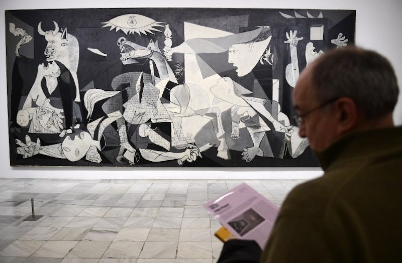 A man looks at Spanish artist Pablo Picasso's painting, 'Guernica' at Reina Sofia museum in Madrid March 24, 2017. — AFP pic