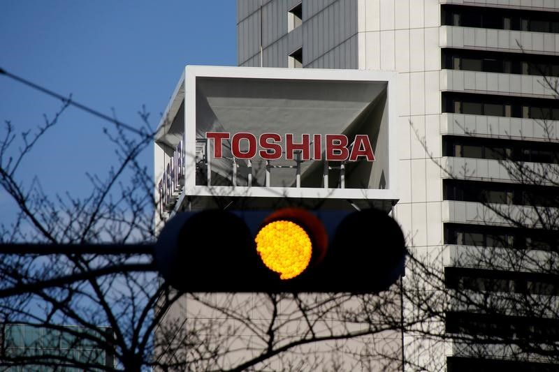 The logo of Toshiba Corp is seen behind a traffic signal at its headquarters in Tokyo January 27, 2017. — Reuters pic