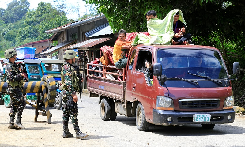 File picture shows Philippine government troops checking a vehicle evacuating residents from their hometown ofMarawicity in southern Philippines, as it drives past a military checkpoint in Pantar town, Lanao Del Norte, Philippines May 24, 2017.— Reuters pic