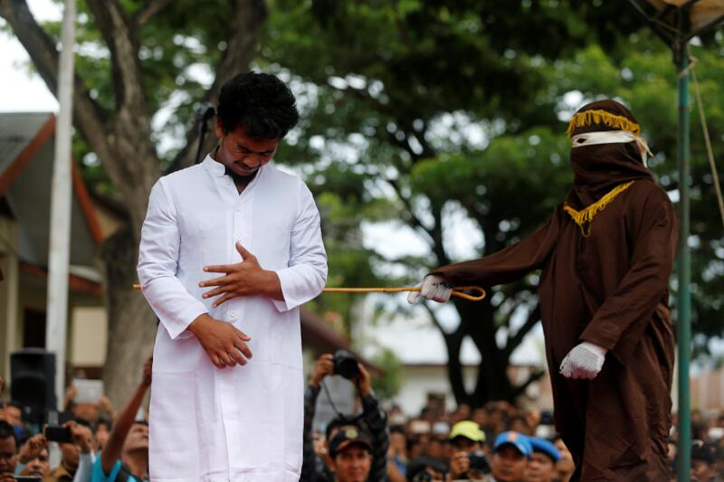 An Indonesian man is publicly caned for having gay sex in Banda Aceh, Aceh province, Indonesia May 23, 2017. — Reuters pic