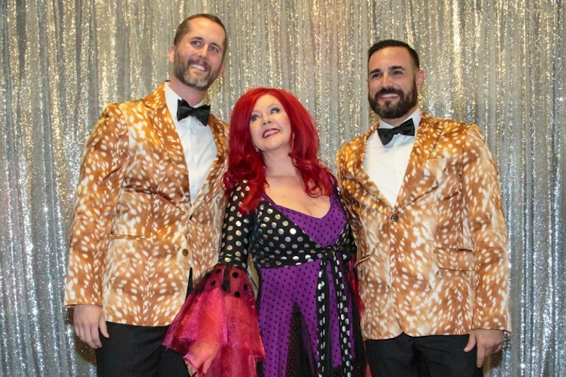 Bernard VandenAvond, Jr (Benny) and Nathan Garcia pose before Kate Pierson, founding member of The B-52's officiates their wedding at ACL Live in Austin, Texas on May 19, 2017.— AFP pic