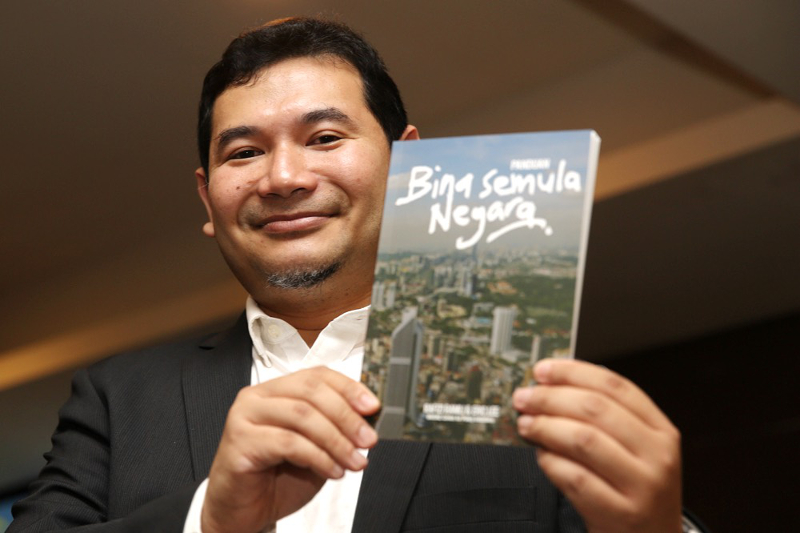 PKR's Rafizi Ramli holds a copy of 'Bina Semula Negara' during the 'INVOKE: A Guide To Rebuilding Our Nation (Vol. 1)' policy launch in Subang May 14, 2017. — Picture by Choo Choy May