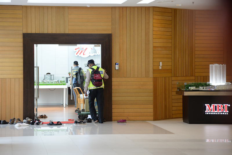 Government officials raid the offices of the MBI Group in M Mall in George Town May 29, 2017. — Picture by KE Ooi