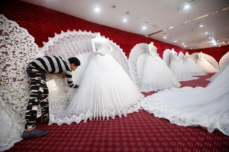 Bridal dresses are displayed at a shop in Yemen's capital Sanaa, April 22, 2017. ― Reuters pic
