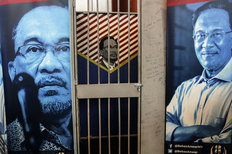 Pictures of Datuk Seri Anwar Ibrahim is seen behind a replica of a prison cell, symbolising the 'Free Anwar Ibrahim' campaign during the 12th PKR National Congress in Shah Alam May 21, 2017. — Picture by Yusof Mat Isa