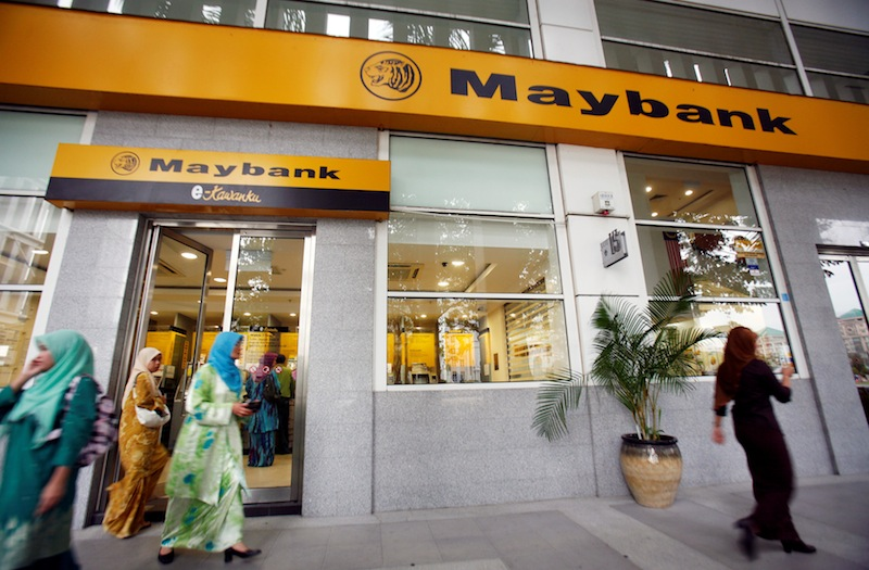Customers leave a branch of Malaysia's Maybank in Putrajaya October 9, 2009.  — Reuters pic