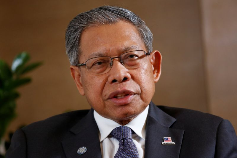 Two Umno supreme council members, Datuk Seri Mustapa Mohamed (pic) and Datuk Seri Anifah Aman, announced their decision to quit just two weeks before the AGM in a move that analysts said underscored the growing internal frustration with Zahid's leadership.  — Reuters pic