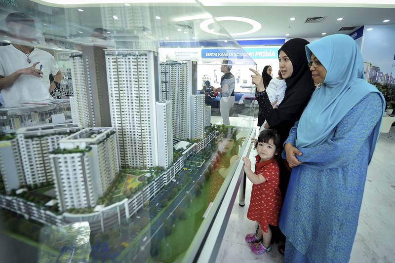 People check out the model of the apartment they wish to buy at Ara Damansara, May 6, 2017. Rehda says the government's affordable housing schemes for Malaysians could in the future be a threat to private developers. — Bernama pic