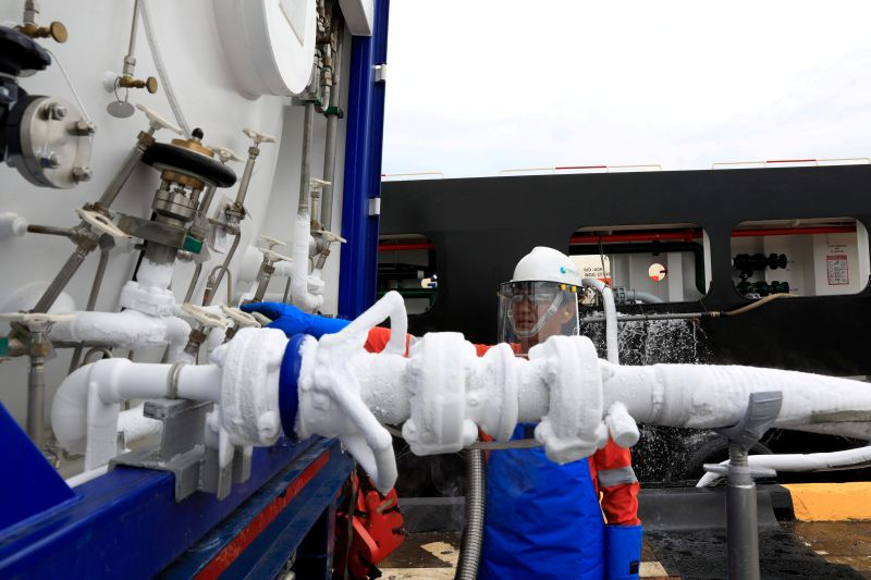 Liquefied natural gas is transferred from an on-shore ISO tank onto a vessel in Singapore in this picture released May 22, 2017. — Reuters pic