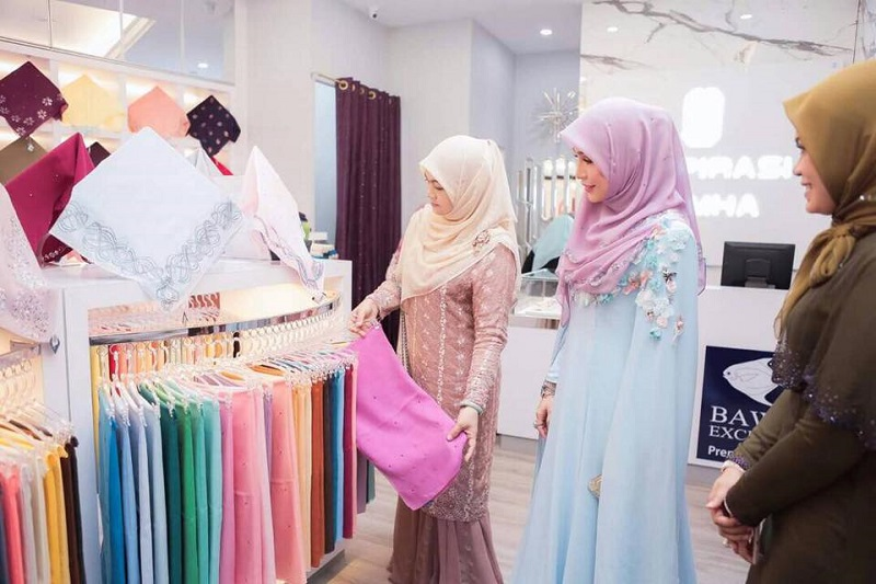 Customers browse Bawal Exclusive's collection during the opening of its branch in Terengganu. — Picture courtesy of Bawal Exclusive