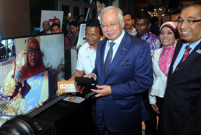 Prime Minister Datuk Seri Najib Razak holding a digital broadcasting receiver after the launch of the myFreeview digital terrestrial television services in Kuala Lumpur, June 6, 2017. — Bernama pic