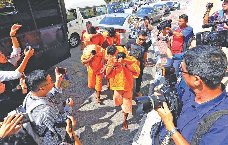The suspects being taken to court yesterday to have their remand extended. — Picture by Sayuti Zainudin
