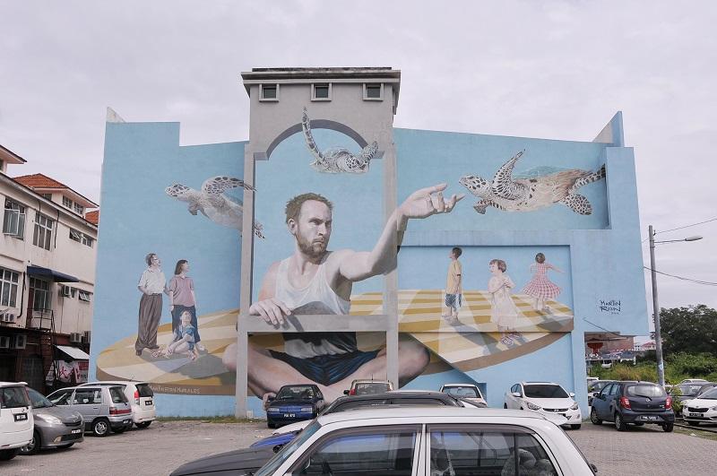 Martin Ron's surreal mural facing a carpark at the Taman Perusahaan Raja Uda.
