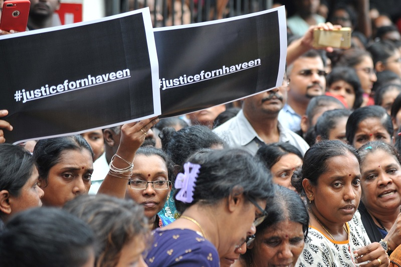Family members and relatives demand justice for T. Nhaveen at the funeral today. — Picture by KE Ooi