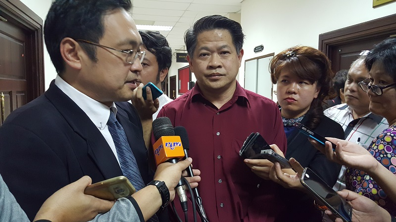 The Sarawak assembly moved to disqualify Dr Ting Tiong Choon (centre) on May 12, 2017 on grounds he held dual citizenship despite the DAP man's argument that he had renounced his Australian citizenship. — Picture by Sulok Tawie