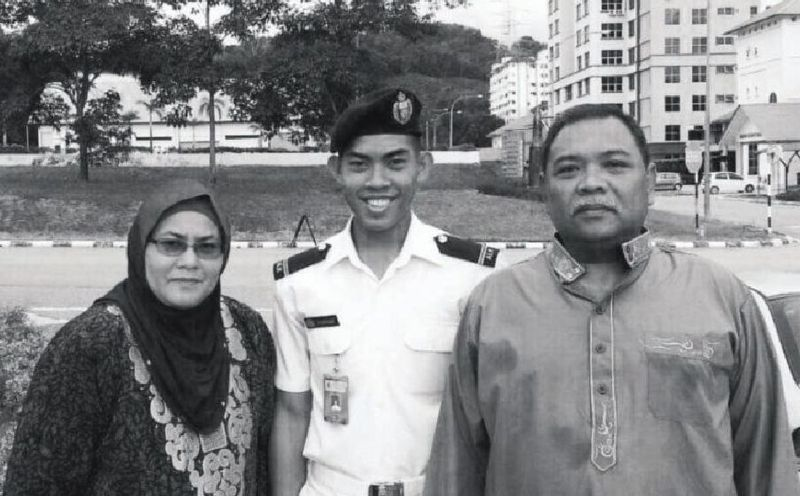 Zulfarhan poses in full ceremonial uniform with his parents at the campus of Universiti Pertahanan Nasional Malaysia. — Picture courtesy of Zulkarnain Idros