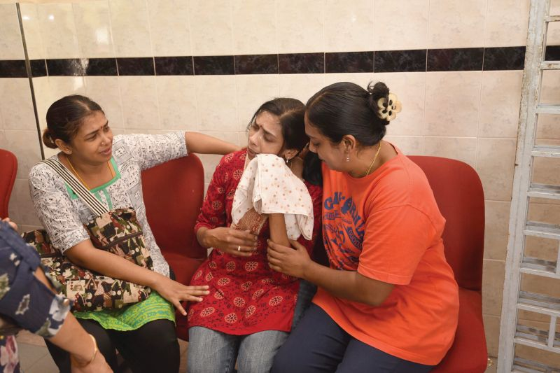 Relatives try to console T. Nhaveen's mother, Shanti (centre), at the Penang Hospital after her son was admitted to the intensive care unit and later declared clinically brain dead  ― Malay Mail pic