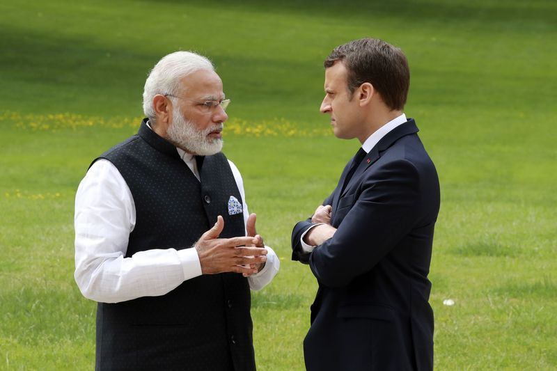 File photo of Indian Prime Minister Narendra Modi (left) speaking with French President Emmanuel Macron in the garden of the Elysee Palace following their meeting in Paris, June 3, 2017. — Reuters pic